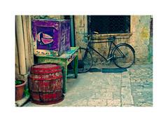 Back yard beauty (CJS*64) Tags: trogir craigsunter croatia cjs64 travel traveling d7000 nikon nikkorlens nikond7000 24mm85mmlens 2485mmlens colour colours barrel bike wheel backstreet box bicycle