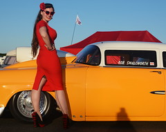 Holly_9269 (Fast an' Bulbous) Tags: trichevy chevrolet car vehicle automobile racecar drag fast speed power doorslammer girl woman chick babe hot sexy pinup model red wiggle dress high heels long brunette hair wife beauty sky nylons stockings