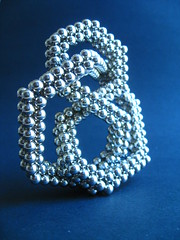 Figure-eight Knot (non FCC) - IMG_0804 (tend2it) Tags: neoball neocube buckyballs cybercube zenmagnet magcube nanodots magnet neodymium zen magnets zenmagnets cool magnetic sculptures art sculpture ball sphere catchy colors silver reflections chrome figure eight knot standing 56