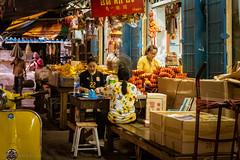 Preparing paper offerings, ChinaTown, Bangkok (Goran Bangkok) Tags: bangkok chinatown chinese thailand paper offering ritual buddhism people shop