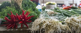 Chili peppers and green onions in the market