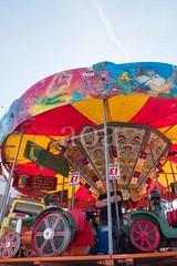 H509_7897 (bandashing) Tags: hyde tameside civicsquare market childrens roundabout gordon cooke sunshine starburst ride sun bluesky light shaft colourful sylhet manchester england bangladesh bandashing aoa socialdocumentary akhtarowaisahmed