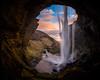 Tunnel vision (modesrodriguez) Tags: blue kvernufoss foss waterfall iceland travel orange sky cascada islandia water clouds sunset