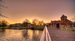 Crossing the bridge. (Alex-de-Haas) Tags: oogvoornoordholland 11mm d850 dutch februari hdr haarlem holland irix nederland nederlands netherlands nikon noordholland photomatix binnenstad building capital center centrum city gebouw hoofdstad house houses huis huizen innercity life stad stadsfotograaf straat street structure sundown sunset town urban water winter woning woningen zonsondergang nl