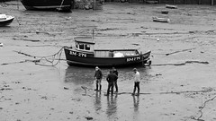 Are you sure this is where we left it ? (Neil. Moralee) Tags: neilmoralee boat sailor mud shore sea ocean men lost water black white mono monochrome humour amusement laughter harbour harbor fishing neil moralee nikon d7200 blackandwhite people candid street fisherman fishermen missing search ship chain rope