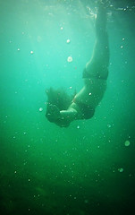 Soothing (jimiliop) Tags: girl diving deep water green sea body hair motion bubbles light underwater
