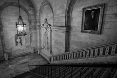 American Gothic: NY Public Library #2 (Kenneth Laurence Neal) Tags: newyorkcity newyorkpubliclibrary staircase gothic statues lowlight architecture noir monochrome blackandwhite nikon nikon1024mm building nikond7100