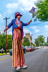 Uncle Sam on stilts! (Beth Bennett & Gérard Cachon) Tags: pennsylvania 4thofjuly independenceday parade unclesam stilts bala cynwyd celebration flag unitedstates us holiday waving redwhiteandblue red white blue sky