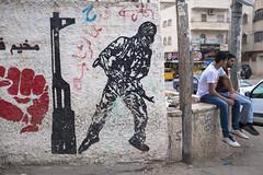The revolutionary past. Qalandiya refugee camp, May 2018. (joelschalit) Tags: revolution streetart ramallah jerusalem israel diversity multiculturalism refugees middleeast streetphotography murals minorities racism war graffiti guns palestine qalandiya