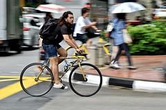Singapore fixie (jeremyhughes) Tags: singapore street bike fixie fixed fixedgear fixedwheel singlespeed trackbike city urban cycling cyclist bicycle mash mashbicycle panning motion movement speed man denim backpack rain umbrellas umbrella nikon d7000 nikkor 18200mmf3556gvr