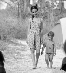 A journey of a thousand miles begins with a single step (ybiberman) Tags: israel desert festival rainbowserpentfestival todler girl walking smile dress braid necklace portrait candid streetphotography people bw