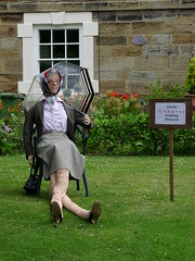 Hinderwell scarecrows 2018 the Queen (Nekoglyph) Tags: hinderwell portmulgrave yorkshire scarecrow festival 2018 village longest reigning monarch queenelizabethii uk legs headscarf umbrella handbag garden