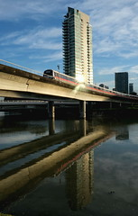 DSCF6539 (jumppoint5) Tags: reflection building train light shadow silhouette sun glare clouds water urban city