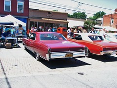 A 1966 OLDSMOBILE NINETY EIGHT IN JULY 2018 (richie 59) Tags: ulstercountyny ulstercounty newyorkstate newyork unitedstates sunday weekend trees automobiles autos motorvehicles vehicles generalmotors saugertiesny saugerties cars oldsmobilenintyeight richie59 america carshow outside crowd people oldsmobile trucks summer luxurycar 1966oldsmobilenintyeight 1966oldsmobile sawyermotorscarshow 2018 july2018 july82018 1966ninetyeight ninetyeight 2010s hudsonvalley midhudsonvalley midhudson ny nys nystate usa us 1960scar americancar uscar village villagestreet street 2door twodoor twodoorhardtop hardtop gm gmcar oldsmobilehardtop redcar oldcar antiquecar oldbuildings buildings storefronts sidewalk sideview backend taillights chrome