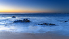 Clear Skies Daybreak Seascape (Merrillie) Tags: daybreak sunrise nature water clearskies cloudless bluesky macmasters centralcoast newsouthwales rocks earlymorning nsw morning sea ocean dawn waterscape landscape coastal macmastersbeach outdoors seascape australia coast sky waves