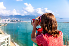A young woman looks at the city through the tower viewer. (Evgeny Ermakov) Tags: asia asian nha nhatrang trang vietnam beach beautiful beauty binoculars blue cityscape clouds destination female joy landscape lifestyle look looking nature observation observationbinoculars observationtelescope observationviewer ocean optical outdoor red sea stationarybinoculars stationarytelescope summer sunlight sunny telescope tourism tourist touristic towerbinoculars towerscope towertelescope towerviewer travel turquoise urban vacation view viewer viewingmachine viewingstand viewingtelescope viewpoint water woman young youngwoman