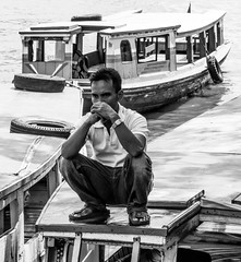 Waiting for the passengers (A. Yousuf Kurniawan) Tags: people river riverlife water boater boat borneo kalimantan streetphotography monochrome urbanlife blackandwhite waiting decisivemoment