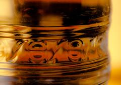plastic bottle abstraction (marinachi) Tags: macromonday macro closeup plastic bottle yellow orange