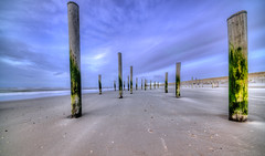 Silent Guards. (Alex-de-Haas) Tags: 11mm adobe d850 dutch hdr holland irix lightroom nederland nederlands netherlands nikon noordholland noordzee northsea petten pettenaanzee photomatix photomatixpro beach beachscape exposure hemel landscape landschap longexposure lucht palen pillars poles sand sea skies sky steunpijler steunpijlers steunpilaar steunpilaren strand sundown sunset supportpillars wind winter zand zee zonsondergang