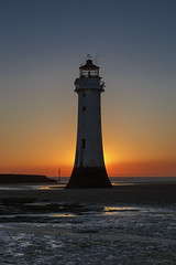If you can't beat 'em, join 'em! (andyrousephotography) Tags: perchrock newbrighton wirral lighthouse beach sand sea lowtide sunset cloudless blue orange yellow red leefilters 06ndmedium