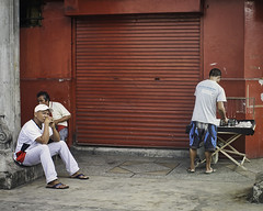 Watching, Waiting (Beegee49) Tags: street men sitting vendor watching waiting curious silay city philippines