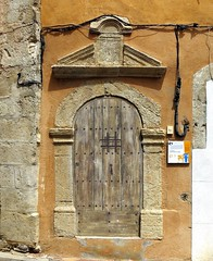 A doorway with a speakeasy window and iron grill, Tavernes, Var, Provence (Spencer Means) Tags: architecture door doorway arch column capital classical old village tavernes var provence france wood wooden window guard grill iron ironwork speakeasy peephole judas dwwg