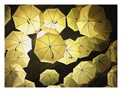 somewhere out there is a yellow umbrella for everyone (undefinable moods) Tags: yellow umbrella somewhere out hope light shadow abstract texture ceiling limit net