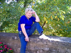 My aunt Lois Greer (Adventurer Dustin Holmes) Tags: outdoor 2004 people person human humans hpphotosmart wall ledge rock stone denimpants bluejeans jeans tennisshoes tennisshoe whiteshoes whitetennisshoes blueshirt female woman carrollcounty eurekaspringsar eurekasprings ozarks bushes leaves trees midwest loisgreer loisdavenport sitting flowers smile smiling portrait fall arm arms tourist vacation trip travel traveling