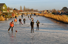 Scating in Ursem (Julysha) Tags: d200 nikkor247028 cnx2 2009 january winter frost mills ice skaiting thenetherlands noordholland dutch schermer ursem schaatsen bridge canal village