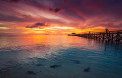 Sunset at Tinabo Island (syukaery) Tags: landscape nikon d750 nikkor indonesia selayar takabonerate tinabo nationalpark seascape boat clouds reflection 1635mm sunset island pier beach