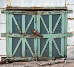 beautiful but beat (Patinagal) Tags: door decay relic deterioration rust peelingpaint garage