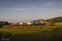 Summer evening freight (Nimbus20) Tags: emrps norfolk northnorfolkrailway charter 2015 summer evening golden hour glow diesel train freight trucks england