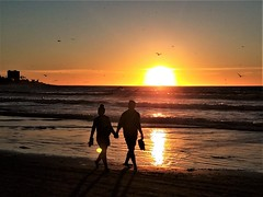 Beach Lovers (moonjazz) Tags: love romance together sharing sunset california photo holdinghands pacificocean sun beach beautiful friends memories eternity today bliss wonder silhouette couple two vacation savor perfect sandiego happy moonjazz walking barefoot peace paradise believe