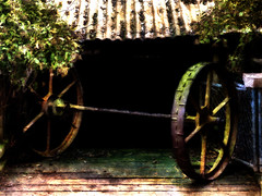 The Runaway (Steve Taylor (Photography)) Tags: axle wheels farmyard barn corrosion gate art digital architecture roof black brown blue green metal iron rust newzealand nz southisland corragated canterbury christchurch tree branch wildlifereserve willowbank