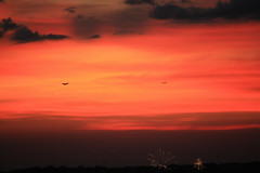 Landing on the 4th of July (Adam's Journey) Tags: 2018 charlotte uptown northcarolina fireworks sunsets favorites airplaines
