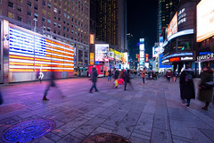Times Square (sk_husky) Tags: newyork nyc timessquare unitedstates usa city cityscape wideangle night buildings flag purple street streetphotography