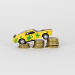 Toy car on coin stack thumbnail