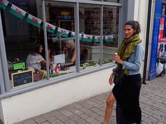 long skirt (watcher330) Tags: carmarthen cafe woman welshflag