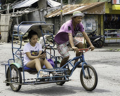 Relaxed (Beegee49) Tags: woman young filipina man rider pedicab public transport bacolod city philippines