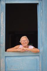 Cuban woman (Mariasme) Tags: portrait woman doorway trinidad cuba blue smile challengeyouwinner matchpointwinner mpt646