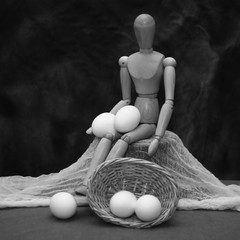 Trying to decide how many eggs he should put in one basket (N.the.Kudzu) Tags: tabletop stilllife wooden mannequin basket eggs canon70d manualfocus primelens russianlens flash bw