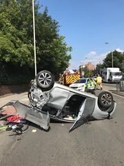 Car on a hot tin roof (Flikrman Gaz) Tags: rtc car upsidedown ohdear emergency crash citroen c1 silver police