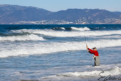 Cast Away (Sam Catanzaro) Tags: california usa america pacificocean surf wave water blue fish fisherman man mountain