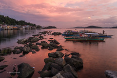 Catbalogan Sunset (pietkagab) Tags: catbalogan sunset town city sea water sky red tones stones rocks boats bangkas fishing fisherman philippines asia asian southeast pietkagab photography pentax pentaxk5ii piotrgaborek travel trip tourism twilight evening adventure