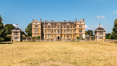 Montacute House (Keith in Exeter) Tags: montacute house mansion building architecture facade hamstone garden wall balustrade pavillion somerset nationaltrust parkland landscape field grass sky tree elizabethan symmetry grand countryhouse panorama
