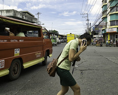 Duck.. (Beegee49) Tags: street jeepney filipina talking phone crossing ducking bacolod city philippines