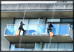 Hanging Precariously from Above . (Irene, W. Van. BC) Tags: hangingprecariouslyfromabove hanging windows balcony windowcleaners men buildings citybuildings highrisebuildings highrises ropes outdoors outdoorscenes heights extremeoccupations dangerous dagerousjobs 1001nights 1001nightsmagiccity 1001nightsmagicwindow harness architecture