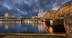 Köln (HaraldNachtmann) Tags: beleuchtet skyline hohenzollernbrã¼cke kã¶lnerdom gebã¤ude auãenaufnahme architektur stã¤dtischesmotiv rhein nachtaufnahme sehenswã¼rdigkeit wasser geschichte stã¤dtereise abendstimmung kã¶ln aussicht abendlicht ruhe wolke stimmung wahrzeichen fluss dom abenddã¤mmerung abend nacht niemand stadtansicht licht himmel bauwerk reiseziel deutschland brã¼cke andachtsort unescowelterbe kirche urban stadt gewã¤sser tourismus nordrheinwestfalen dã¤mmerung reise