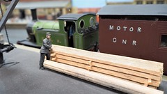 A Quick Rest for the Railwayman. (ManOfYorkshire) Tags: gnr greatnorthernrailway railway train layout 143 scale ogauge steam loco engine locomotive wagon goods goodsyard crane railwayman porter staff load middletonrailway show display exhibition 2018