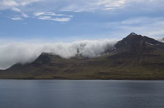 Clouds spilling over mountains in the eastern fjords of Iceland